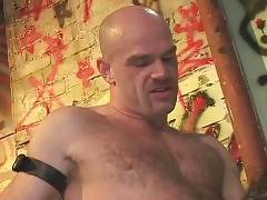 Muscled daddy and naughty guy exchange passionate blowjobs.