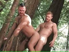 Watch two muscled horny dudes are fucking in wood.