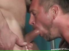 Three hungry dudes  with big muscles suck and kiss each other.